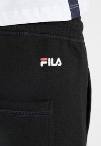 Fila Tall - PURE BASIC PANTS - Tracksuit bottoms - black - 4