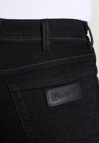 Wrangler - TEXAS STRETCH - Straight leg jeans - raven - 4