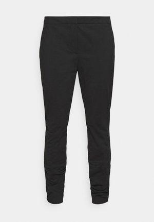 HARULA - Trousers - black