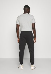 Nike Sportswear - CARGO PANT - Träningsbyxor - black - 2