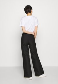 DESIGNERS REMIX - HAILEY FLARE - Trousers - black - 2