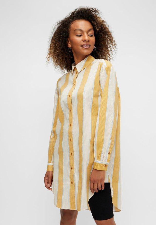 Camisa - nugget gold