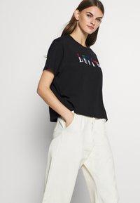 Levi's® - GRAPHIC VARSITY TEE - Print T-shirt - multicolor/black - 4
