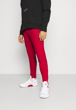 AIR PANT - Pantaloni sportivi - gym red/black