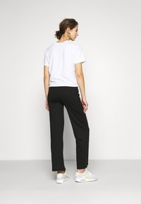ONLY - ONLFEVER WIDE PANTS - Tracksuit bottoms - black - 2