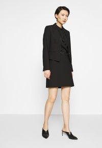 HUGO - RIATA - Áčková sukně - black - 1