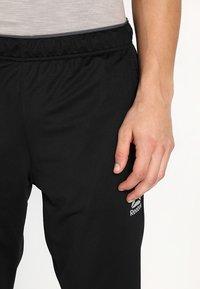 Reebok - TRAINING TRACK PANTS - Tracksuit bottoms - black - 3