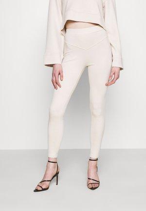 NINETTE - Leggings - beige