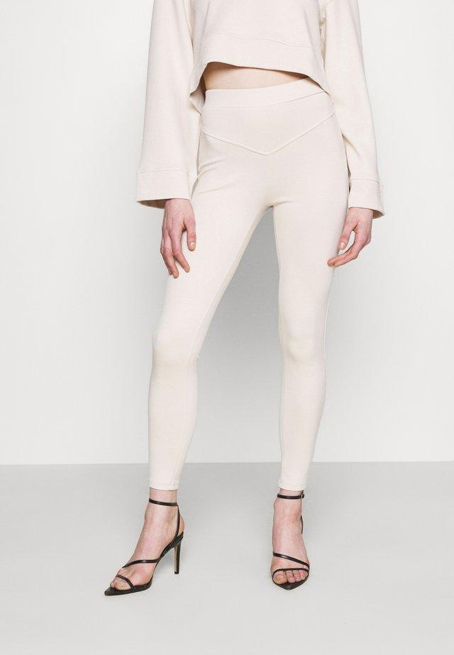 NINETTE - Leggings - Trousers - beige