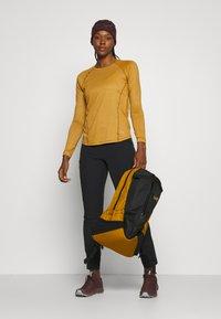 Arc'teryx - SABRIA WOMEN'S - Outdoor trousers - black - 1