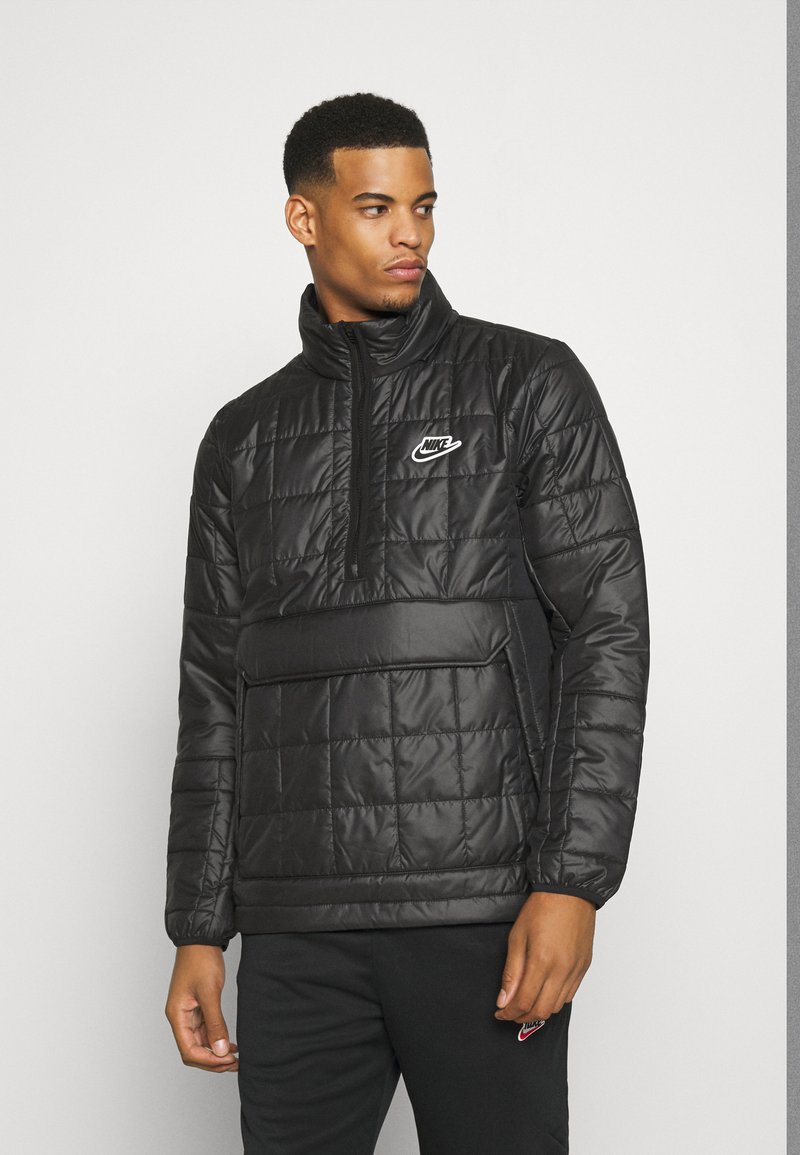 Nike Sportswear - ANORAK - Light jacket - black