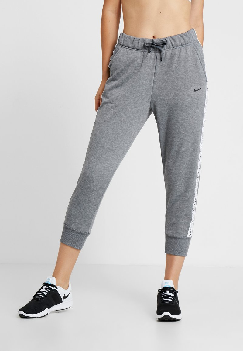 Nike Performance - DRY GET FIT - Tracksuit bottoms - carbon heather/black