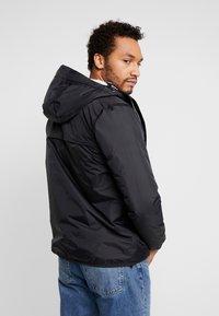 K-Way - UNISEX CLAUDE ORESETTO - Light jacket - black - 2