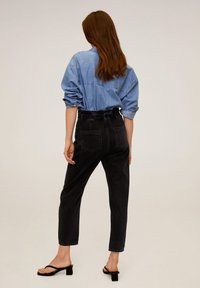 Mango - SLOUCHY - Relaxed fit jeans - black denim - 2