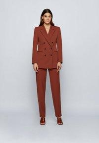 BOSS - TISLETTI - Trousers - brown - 1
