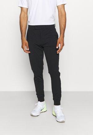 AIRLIGHT TRACKIES - Pantalon de survêtement - true black