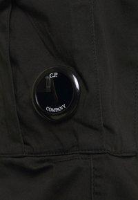 C.P. Company - PANTS - Cargo trousers - black - 5