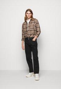 Han Kjøbenhavn - Relaxed fit jeans - black - 1