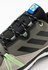 adidas Performance - TERREX SKYCHASER  - Hiking shoes - legend green/core black/signal green - 5