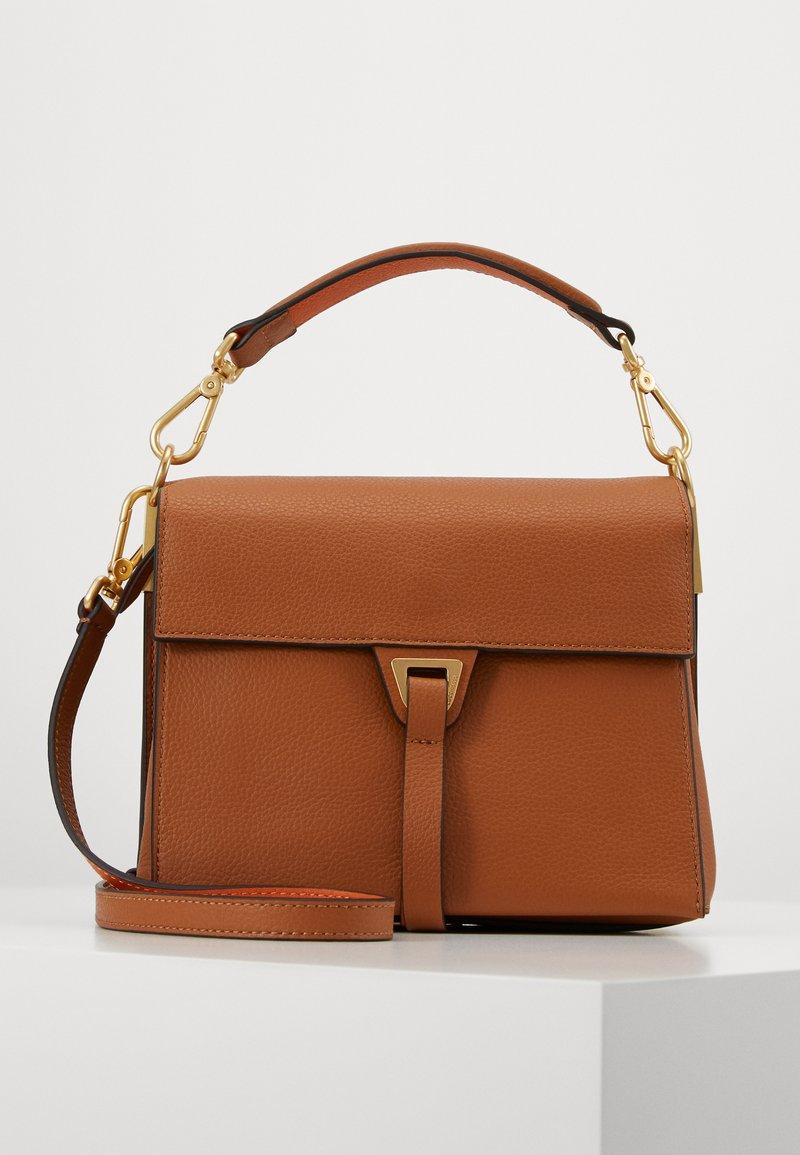 Coccinelle - LOUISE - Handbag - caramel/ginger