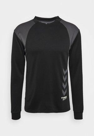 HMLKIRBY - T-shirt z nadrukiem - black