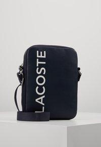 Lacoste - VERTICAL CAMERA BAG - Across body bag - dark sapphire - 0
