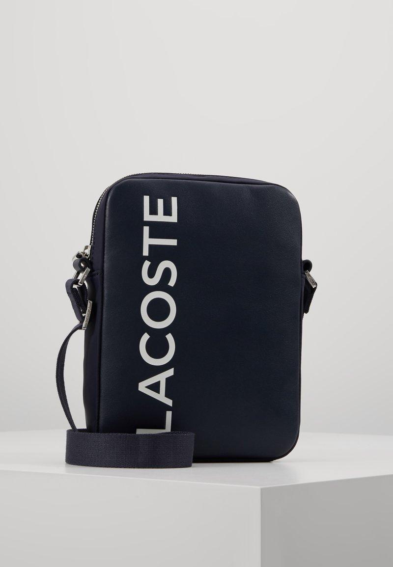 Lacoste - VERTICAL CAMERA BAG - Across body bag - dark sapphire