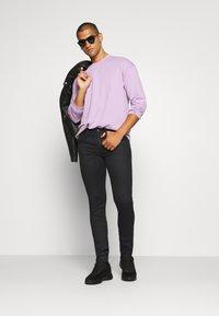 Replay - ANBASS HYPERFLEX RE-USED - Jeans Skinny - black - 1