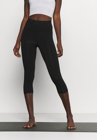 Deha - LEGGINGS 3/4 - 3/4 sports trousers - black - 0