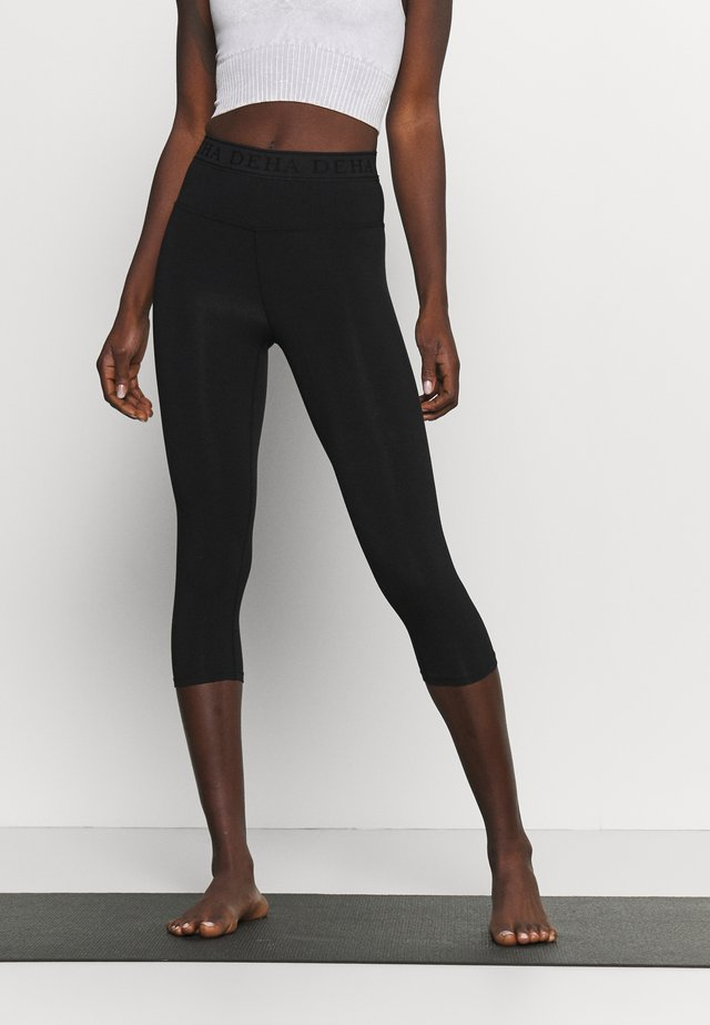 LEGGINGS 3/4 - Pantalon 3/4 de sport - black