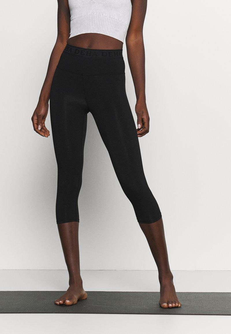 Deha - LEGGINGS 3/4 - 3/4 sports trousers - black