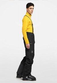 Haglöfs - LUMI LOOSE PANT - Snow pants - true black - 1