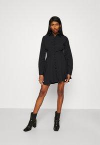 Missguided - BUTTON DOWN SKATER DRESS - Shirt dress - black - 1