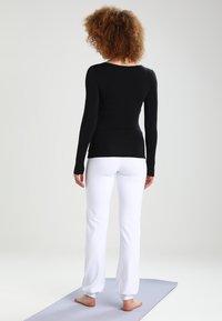 Curare Yogawear - Topper langermet - black - 2