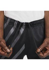 Nike Sportswear - SUBSET - Træningsbukser - black - 6