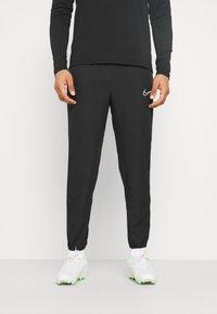 Nike Performance - DRY PANT - Spodnie treningowe - black/white - 0