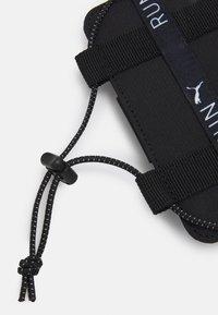 Puma - PHONE HOLDER UNISEX - Autres accessoires - black - 2