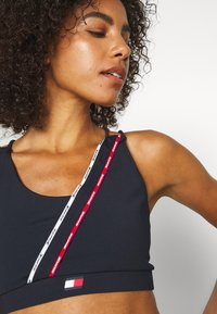 Tommy Hilfiger - LOW SUPPORT BRA PIPING - Light support sports bra - blue - 3
