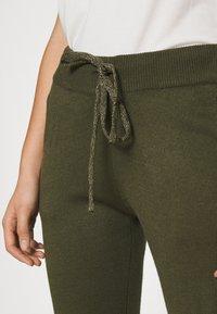 ONLY - ONLAUBREE LOOSE PANTS  - Tracksuit bottoms - kalamata - 4