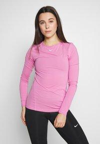Nike Performance - ALL OVER - Camiseta de deporte - magic flamingo/white - 0