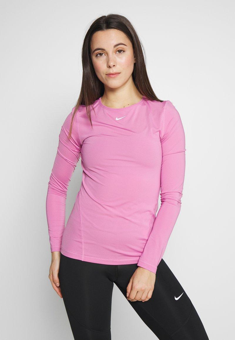 Nike Performance - ALL OVER - Camiseta de deporte - magic flamingo/white