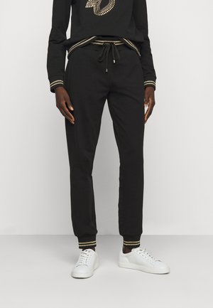 JOGGER - Tracksuit bottoms - nero/gold