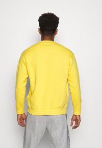 Champion - CREWNECK - Mikina - yellow - 2