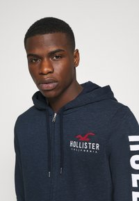 Hollister Co. - TECH LOGO UPDATE - Zip-up hoodie - navy - 4
