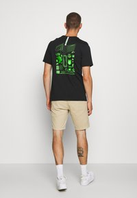 Nike Sportswear - M NSW WORLDWIDE GLOBE  - T-shirt imprimé - black - 2