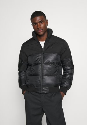 MATTE AND SHINE PUFFER - Winter jacket - black