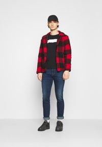 Diesel - YENNOX - Slim fit jeans - dark blue - 1