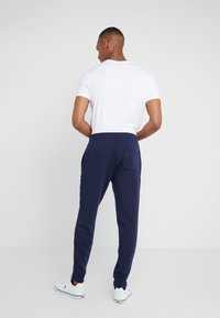 Polo Ralph Lauren - Tracksuit bottoms - cruise navy - 2