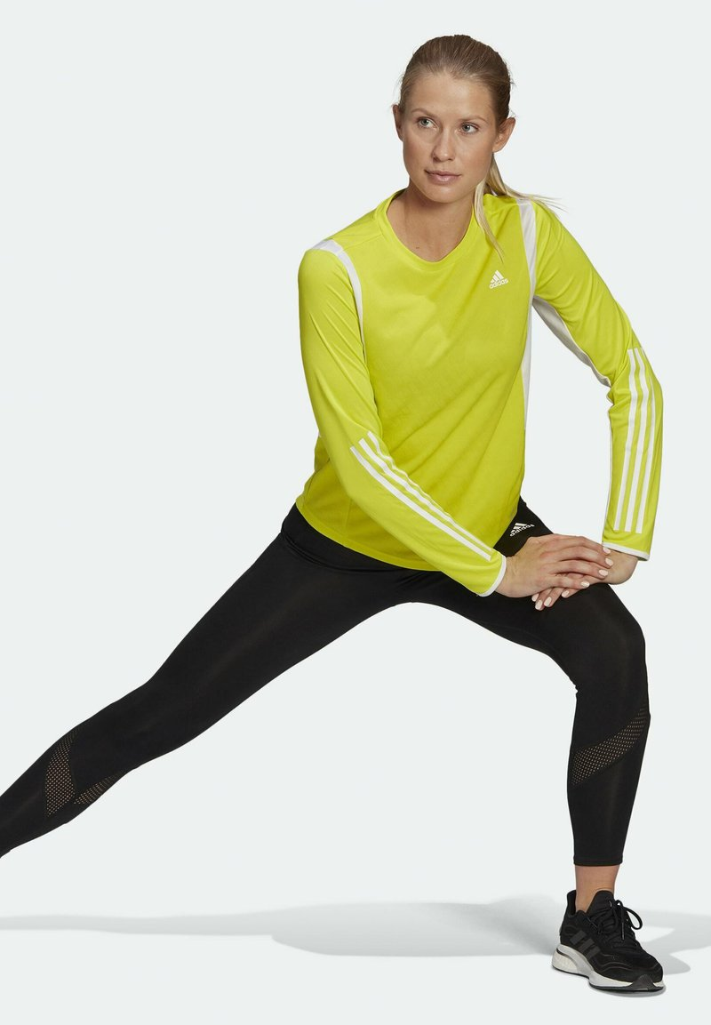 adidas Performance - OWN THE RUN 3-STRIPES RUNNING LONG-SLEEVE TOP - Long sleeved top - yellow