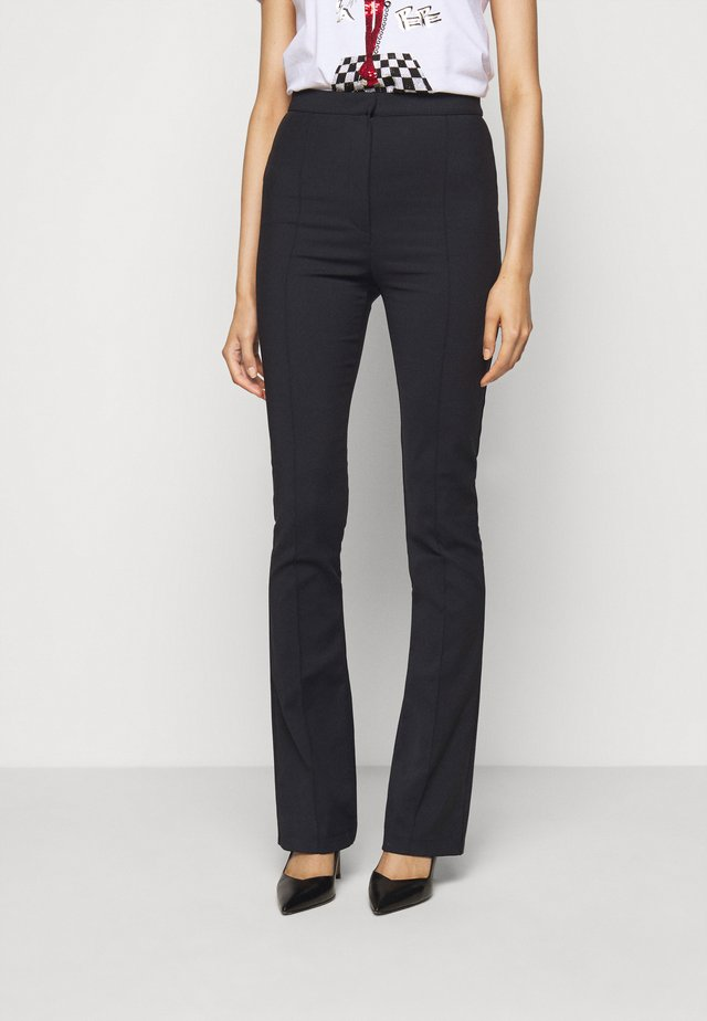 FLARED TROUSERS - Pantalones - nero